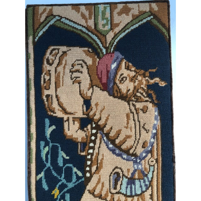 This framed Needlepoint picture of a medieval drummer has beautiful coloring and details and will add a mystical richness...