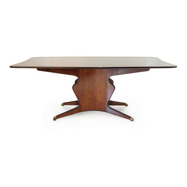 Expansive Italian dining table in the style of Osvaldo Borsani. This handsome table is fabricated from a beautiful bold-...