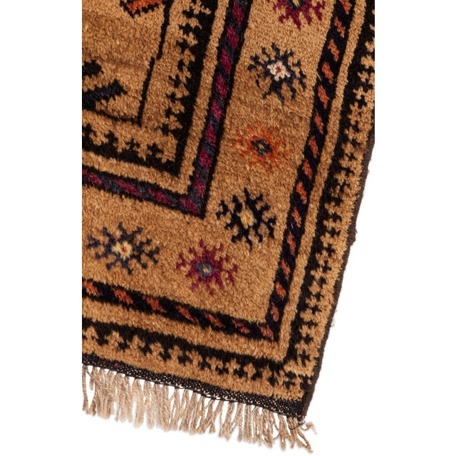 Stunning and soft geometrically patterned Turkish area rug with rich, muted jewel-tone colors and fringe. Great condition.