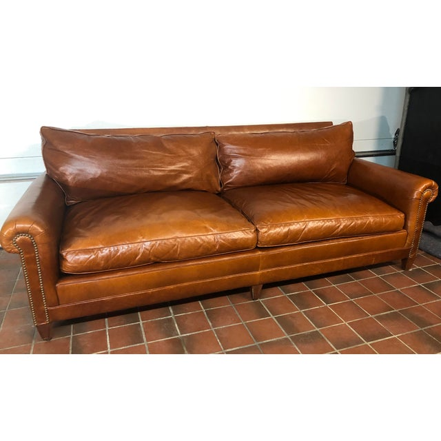 This Ralph Lauren MacIntyre leather sofa is in great shape. The cushions are down filled. The leather is a warm...