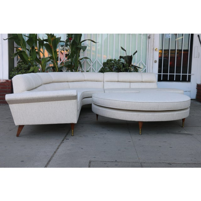 Mid Century Modern Reupholstered 3 Piece Sectional and Big Ottoman. Legs are very sturdy and fabric is well kept. Very...