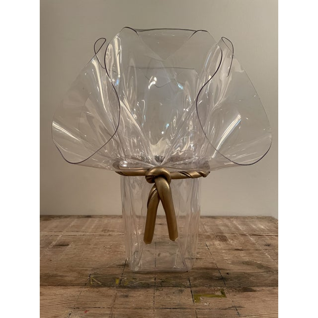 Very stylish large crystal clear Lucite planter or vase. Oversized handkerchief shape with gilded Lucite bow. Stunning! No...