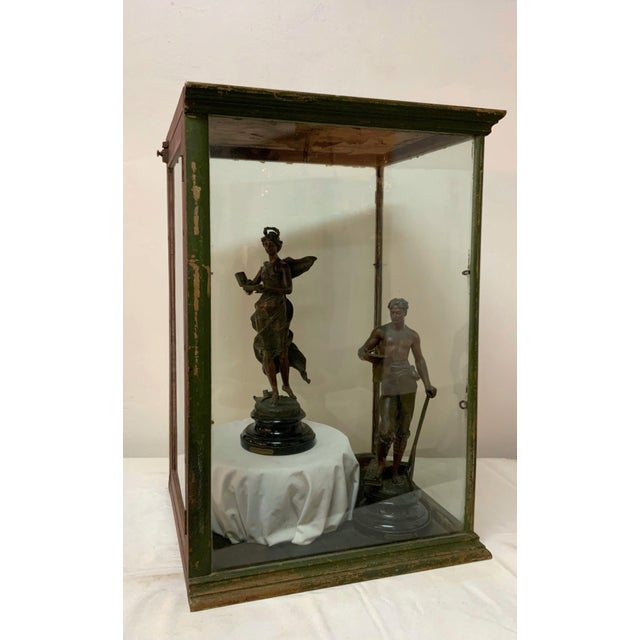 Extraordinary 19th Century metal and glass display case. The sturdy metal frame was painted at some point, giving this...