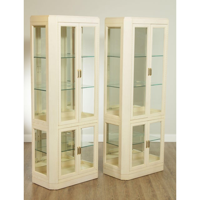 High quality American made vintage pair of 4 door mirror back vitrines with thick adjustable glass shelves. Store Item#:...