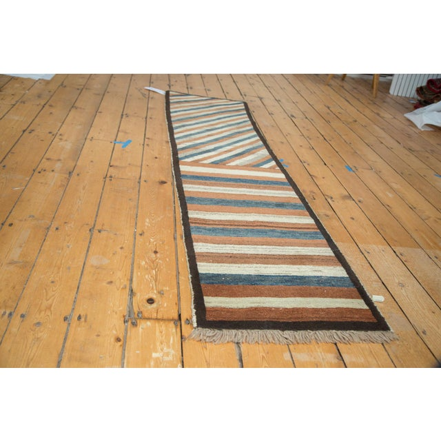 Traditional Qashqai Gabbeh diagonal striped lines in colors including ivory, light copper, teal blue, and speckled...