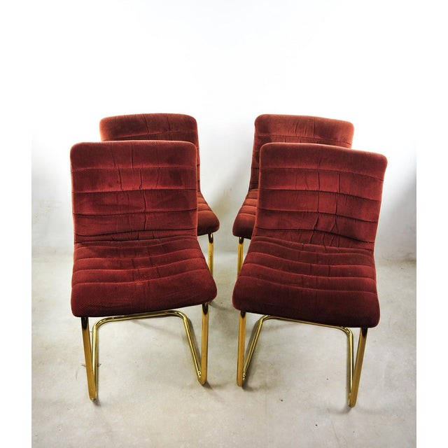 For your consideration is this set of four Douglas gold tone tubular steel cantilever chairs. The chairs feature cushions...