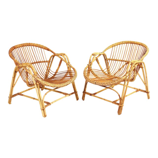 1960s French Rattan Lounge Chairs - A Pair For Sale