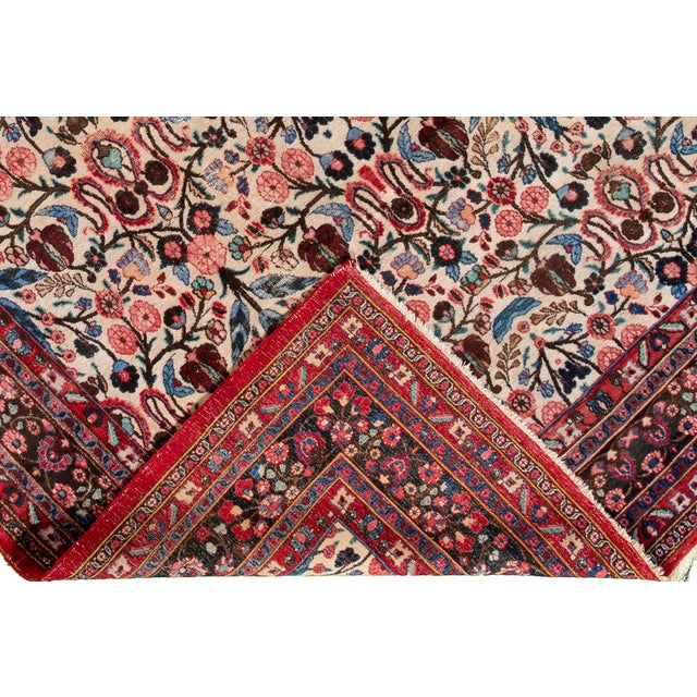 Vintage hand-knotted Persian rug with a floral motif. This piece has great colors and a beautiful design. It would be the...