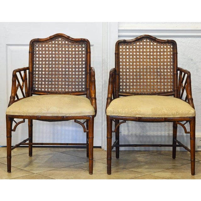 This pair of elegant chinoiserie Chippendale style armchairs are made of wood carved in the shape of bamboo. The back...