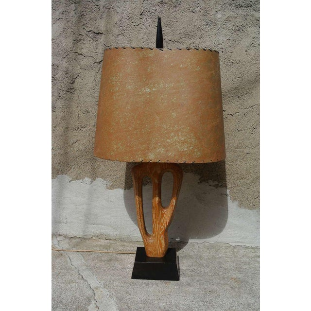 Free-form abstract limed oak table lamp on lacquered mahogany base by Yasha Heifetz. Shade is original.