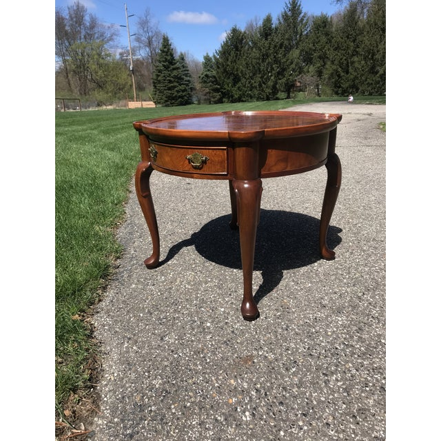 Wonderful walnut and checker veneer top on this circular table made by Hekman furniture of Grand Rapids. Splash this piece...
