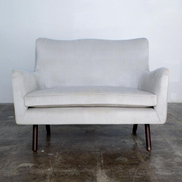 """Modern Duplex settee in dove gray velvet. This piece is very versatile and can mix with a variety of decor styles. 18""""..."""