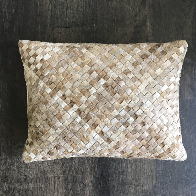 Williams Sonoma woven leather hide throw pillow in tan. Handwoven cowhide creates amazing texture and soft, natural shifts...