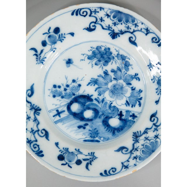 A superb antique 18th-Century Dutch Delft faience flower garden plate. This lovely plate has hand painted flowers, fence,...