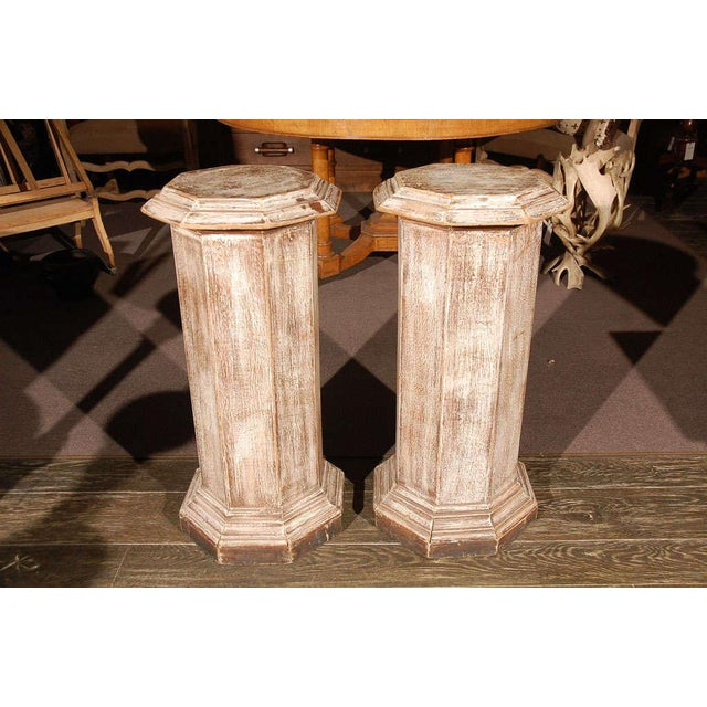 Pair of octagonal beveled top columnar plinths or stands from 19th century England.