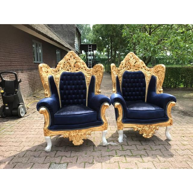 A beautiful set of 2 chairs in Italian Rococo/Baroque style. Recently re-gilt frame with gold leaf and re-cently re-...