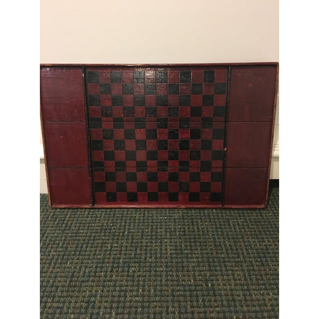 Antique checkerboard- red and black. Strung with wire to hang on wall.