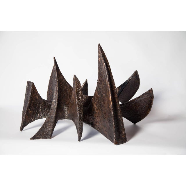Contemporary bronze sculpture done by New York based Sculptor, BJ Las Ponas. To create a piece, Las Ponas cuts sheets of...