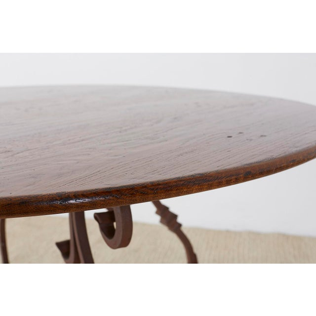Italian Oak and Scrolled Iron Round Dining Table For Sale In San Francisco - Image 6 of 13