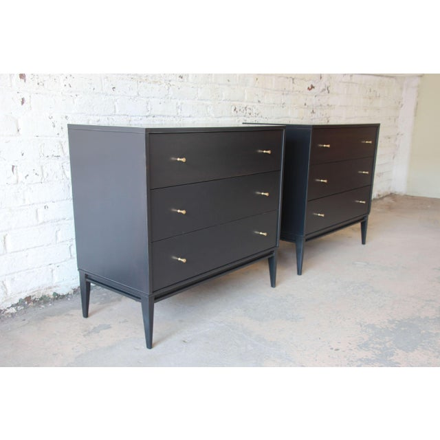 Offering an outstanding pair of Paul McCobb Planner Group three drawer chests or nightstands. The chests are newly...