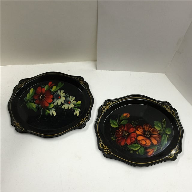 Lovely small floral hand painted black trays. Minor wear on backs.