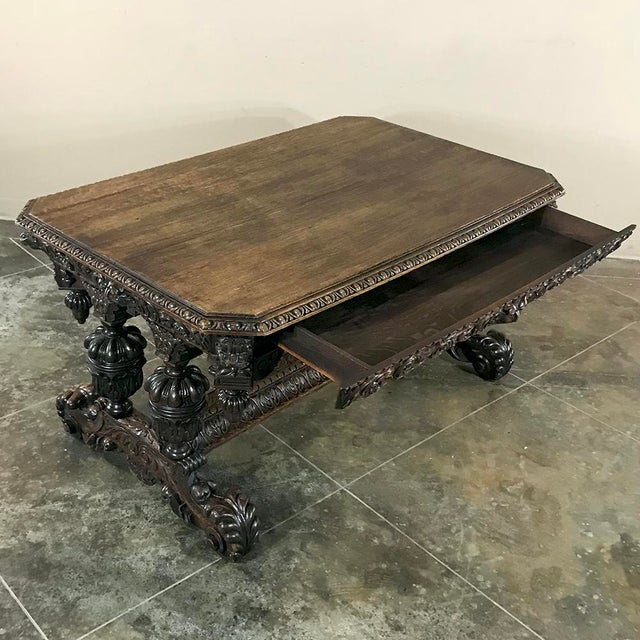 19th Century French Renaissance Writing Table with Dolphins immortalizes the sea creatures in classic Parisienne fashion,...