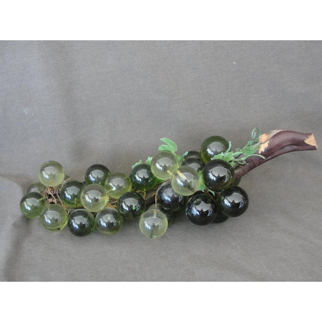Vintage mid-century green lucite grapes on stick cluster This is a nice cluster of green Lucite grapes on a large branch....