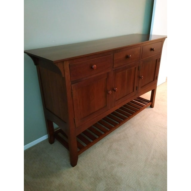 Arts and crafts style cherry buffet from the American Impressions collection by Ethan Allen. Features a rectangular top...