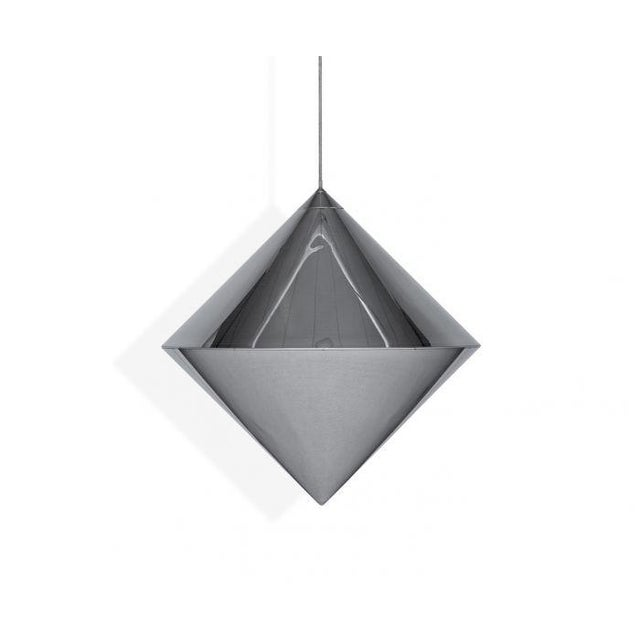 Delicate and elegant, the severe geometry of the acidetched conical form of Top is reduced but instantly recognizable. A...