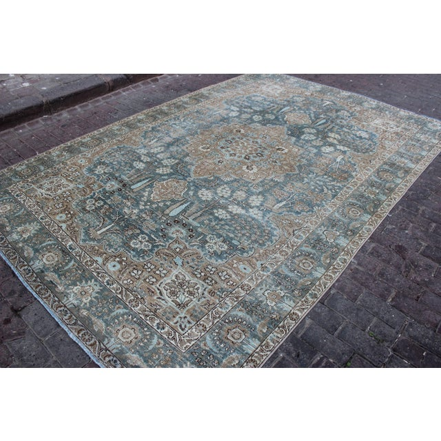 Vintage Tabriz Persian rug with colors of peacock, robin's egg blue and cocoa. Rug has been shaved and hand distressed to...