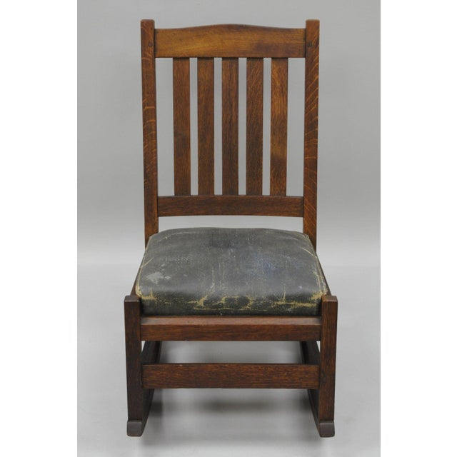 "Item: Antique Signed L.&J.G. Stickley Oak Youth ""Nursing"" Rocking Chair Details: Solid oak wood construction, wood pin..."