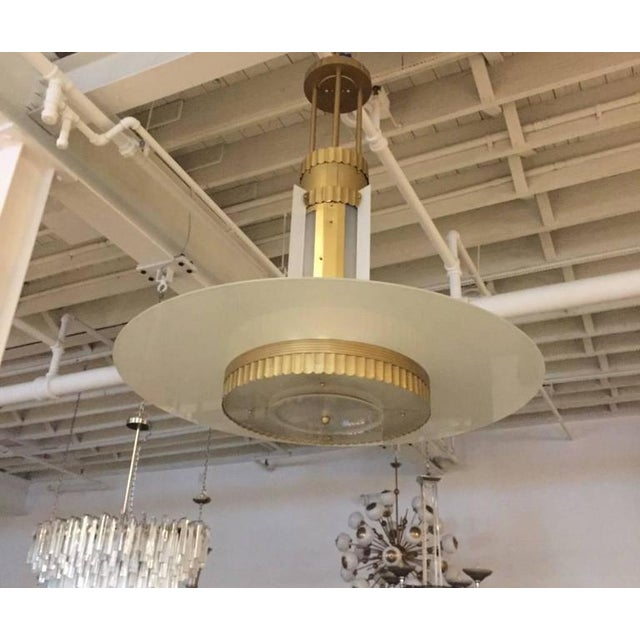 Stunning Art Deco grand theater chandelier. Having a ribbed motif on the metal along with incredible Deco details...