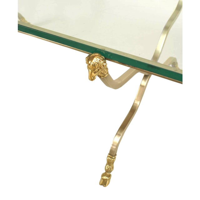 French Directoire style (20th century) steel six legged rectangular coffee table with brass ram heads and feet supporting...