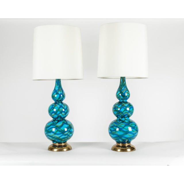 Vintage porcelain pair of table lamps with brass base. Each lamp in excellent working condition. Each lamp measure 32...