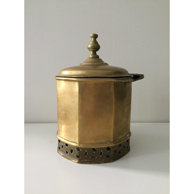 Unusual brass kettle / container that I found in an antique store. I was told that it was Moroccan, likely used as a...