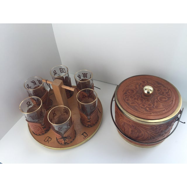 "Unique bar set by M.L. Leddy of San Angelo TX. Includes 12"" R wood serving caddy with stem and handle that has two..."