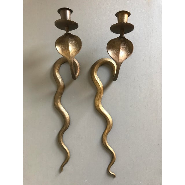 Unique pair of cobra wall mount candle holders. The pair comes from early 20th century India and has a Egyptian...