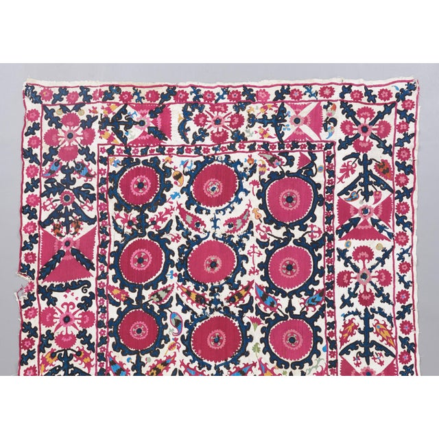 In true to form Tashkent fashion, round blossom forms rendered in a radiant red are the primary motif in this colorful...