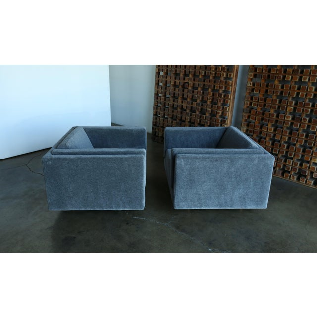 Harvey Probber lounge chairs circa 1960. This pair has been expertly restored in thick luxurious grey mohair. The listed...