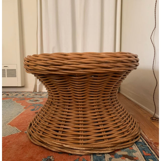 It is constructed of sturdy wicker material and the pattern for the weaving is thick like a sweater. It has natural wear...