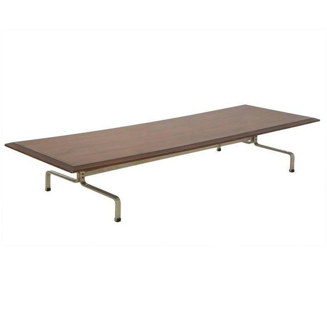 This long and sleek coffee table has an identical and indistinguishable base that matches the PK-31 series by Poul...