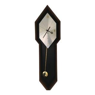 Howard Miller George Nelson/Arthur Umanoff Mid-Century Walnut Pendulum Clock For Sale