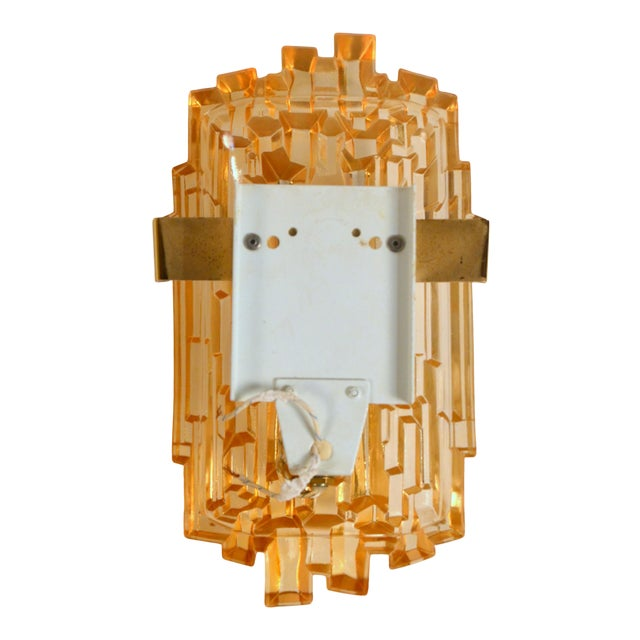 Pair of chic French 70's brutalist glass sconces. Thick molded glass covers insert into discrete plates with brass...