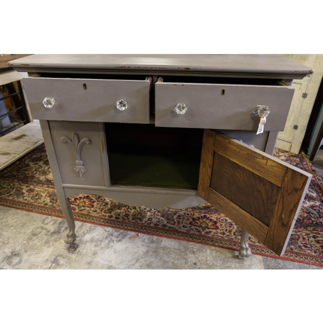 Petite side cabinet for any smaller space! Hand carved with clawfeet in the front. Restored and repainted by local...