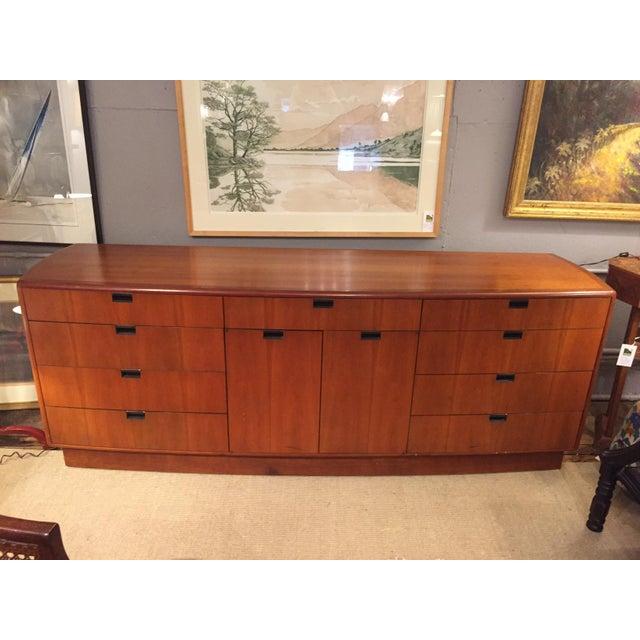 Sleek mid century modern mahogany sideboard by Dunbar having lots of storage and cool black recessed pulls. Very good...
