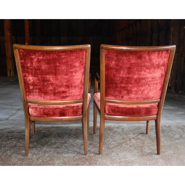 Circa 1960 A nice pair of velvet upholstered armchairs with dark stained wood frames in the style of T. H. Robsjohn-...
