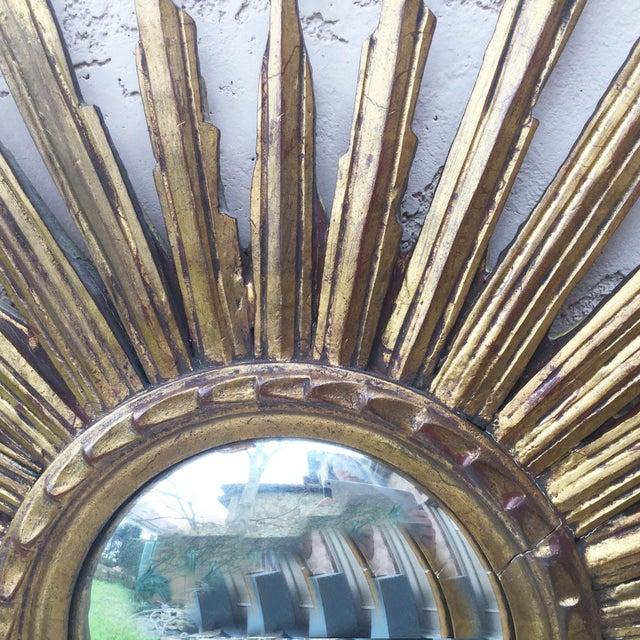Large French convex sunburst gilded wood mirror, circa 1950.