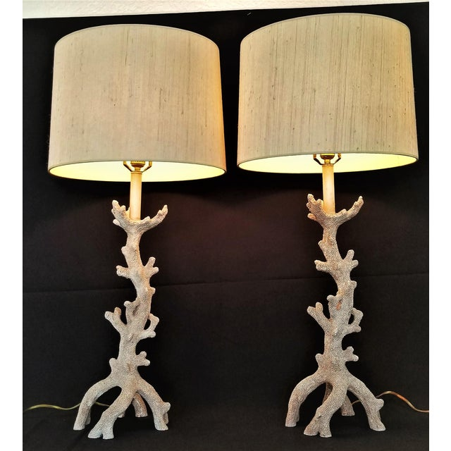 Offering a sophisticated pair of faux coral table lamps, circa 1980s- 1990s. These large Organic Modern lamps are made of...