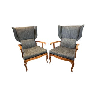A Pair of Italian Walnut Open Arm Wing Chairs For Sale