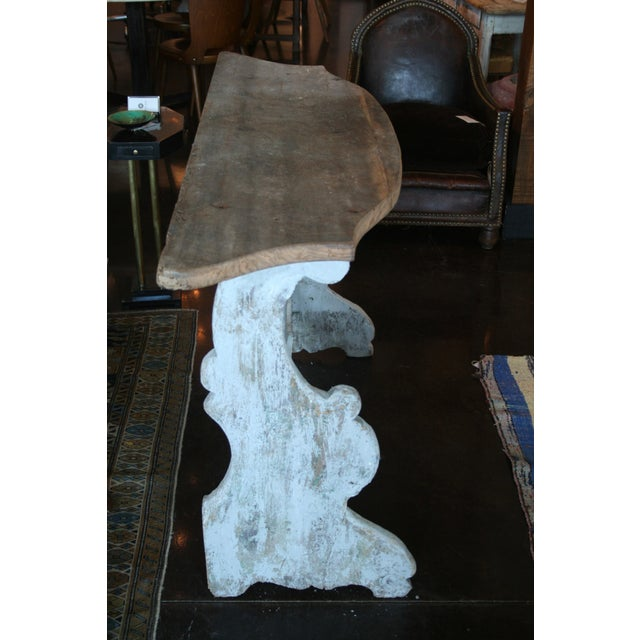 Italian demi-lune table with painted decorative stretcher base and wooden plank top. *Please remember: The majority of our...